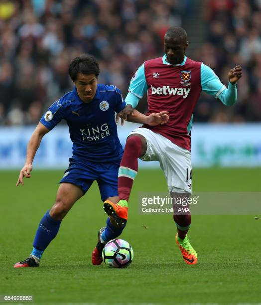 Shinji Okazaki of Leicester City and Pedro Mba Obiang of West Ham during the Premier League match between West Ham United and Leicester City at...