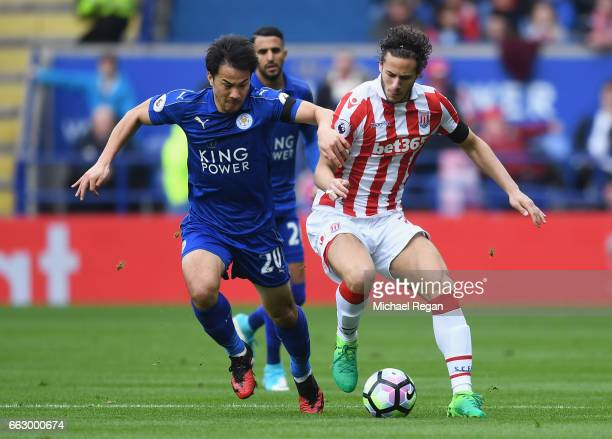 Shinji Okazaki of Leicester City and Ramadan Sobhi of Stoke City battle for possession during the Premier League match between Leicester City and...