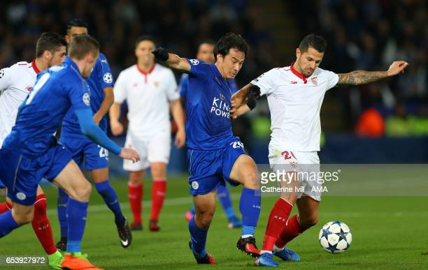 Shinji Okazaki of Leicester City and Vitolo of Sevilla during the UEFA Champions League Round of 16 second leg match between Leicester City and...