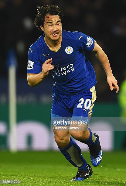 Shinji Okazaki of Leicester City celebrates as he scores their first goal with an overhead kick during the Barclays Premier League match between...