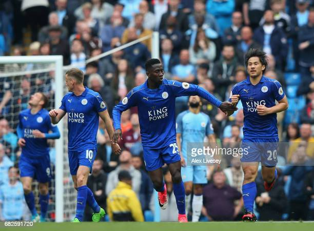 Shinji Okazaki of Leicester City celebrates scoring his sides first goal with Wilfred Ndidi of Leicester City the Premier League match between...