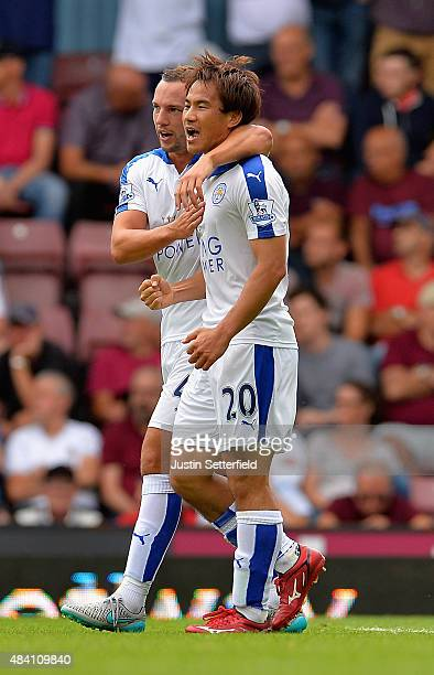 Shinji Okazaki of Leicester City celebrates scoring his team's first goal with his team mate Danny Drinkwater during the Barclays Premier League...
