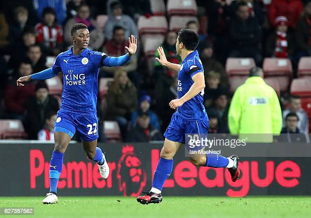 Shinji Okazaki of Leicester City celebrates scoring his team's first goal with his team mate Demarai Gray during the Premier League match between...
