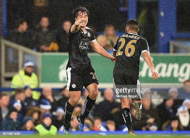 Shinji Okazaki of Leicester City celebrates scoring his team's third goal with his team mate Riyad Mahrez during the Barclays Premier League match...
