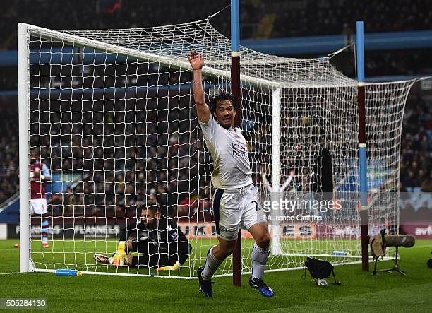 Shinji Okazaki of Leicester City celebrates scoring the opening goal during the Barclays Premier League match between Aston Villa and Leicester City...