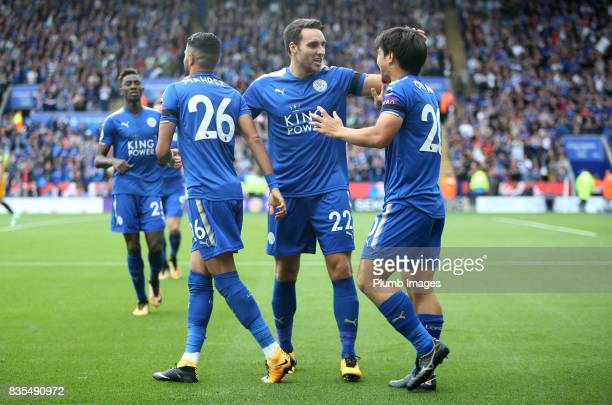 Shinji Okazaki of Leicester City celebrates with Riyad Mahrez and Matty James of Leicester City after scoring to make it 10 during the Premier League...