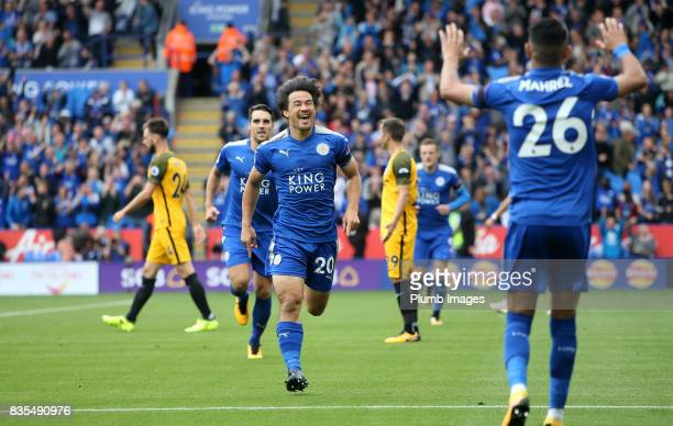 Shinji Okazaki of Leicester City celebrates with Riyad Mahrez of Leicester City after scoring to make it 10 during the Premier League match between...