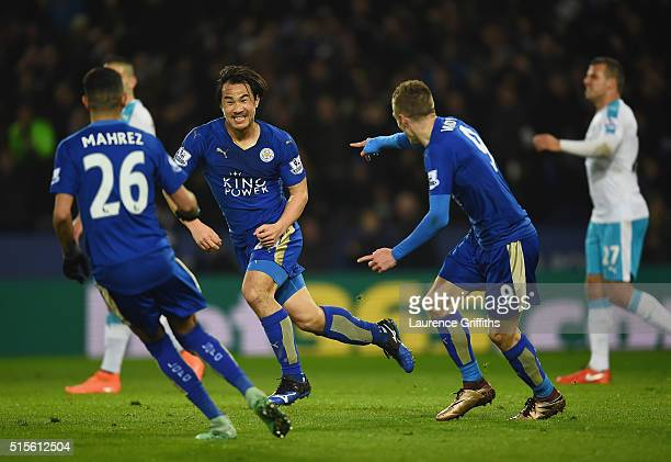 Shinji Okazaki of Leicester City celebrates with team mates as he scores their first goal with an overhead kick during the Barclays Premier League...