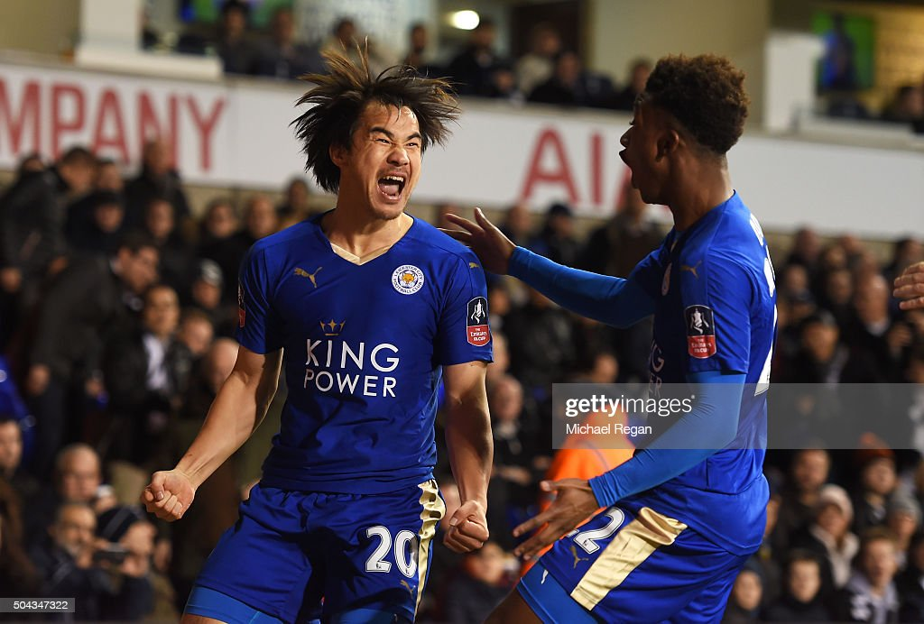 Shinji Okazaki (L) of Leicester City celebrates with teammate Demarai Gray after scoring his team's second goal during The Emirates FA Cup third round match between Tottenham Hotspur and Leicester City at White Hart Lane on January 10, 2016 in London, England.