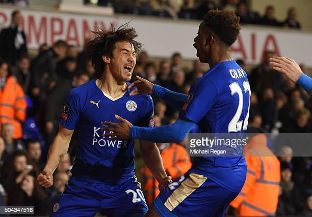 Shinji Okazaki of Leicester City celebrates with teammate Demarai Gray after scoring his team's second goal during The Emirates FA Cup third round...