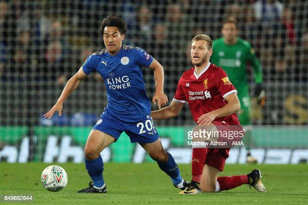 Shinji Okazaki of Leicester City competes with Ragnar Klavan of Liverpool during the Carabao Cup third round match between Leicester City and...