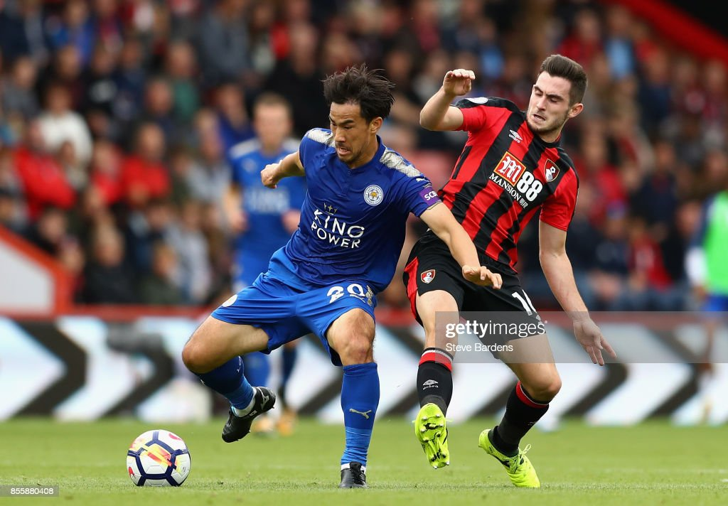 Shinji Okazaki of Leicester City controls the ball under pressure of Lewis Cook of AFC Bournemouth during the Premier League match between AFC Bournemouth and Leicester City at Vitality Stadium on September 30, 2017 in Bournemouth, England.