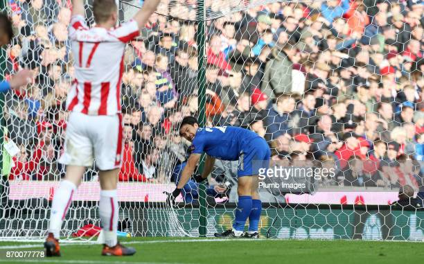 Shinji Okazaki of Leicester City gets tangled in the net during the Premier League match between Stoke City and Leicester City at Bet365 Stadium on...