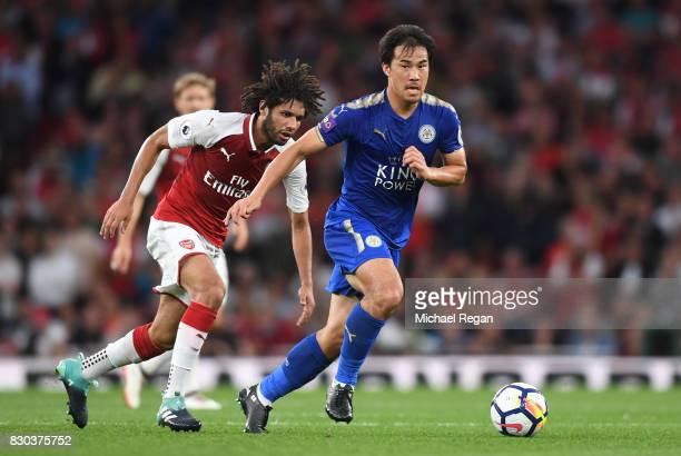 Shinji Okazaki of Leicester City goes past Mohamed Elneny of Arsenal during the Premier League match between Arsenal and Leicester City at the...