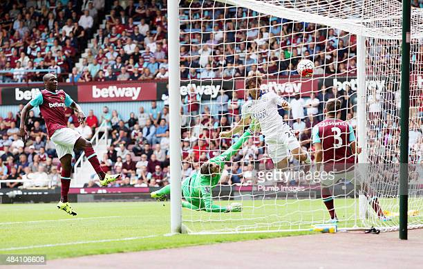 Shinji Okazaki of Leicester city heads the ball past Adrain of West Ham to make it 01 during the Barclays Premier League match between West Ham...