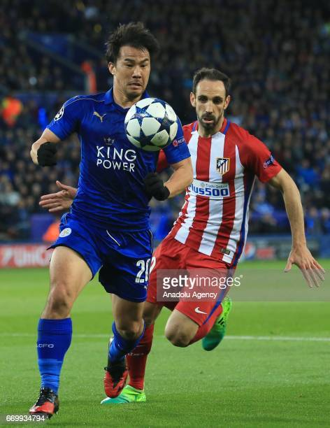 Shinji Okazaki of Leicester City in action against Juanfran of Atletico Madrid during Champions League Quarter Final second leg soccer match between...