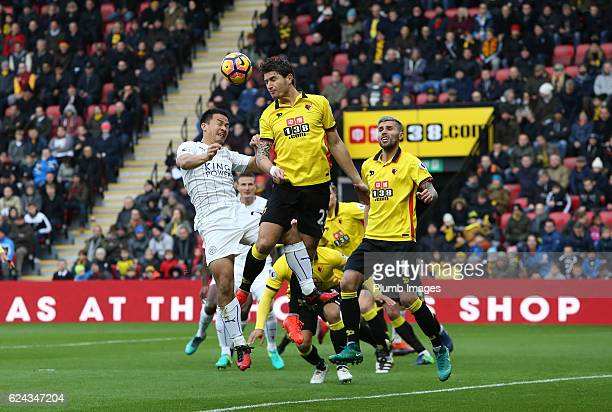 Shinji Okazaki of Leicester City in action with Daryl Janmaat of Watford during the Premier League match between Watford and Leicester City at...