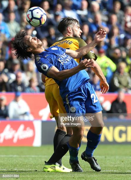 Shinji Okazaki of Leicester City in action with Davy Propper of Brighton and Hove Albion during the Premier League match between Leicester City and...