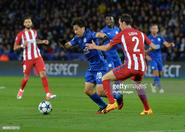 Shinji Okazaki of Leicester City in action with Diego Godin of Atletico Madrid during the UEFA Champions League Quarter Final Second Leg match...