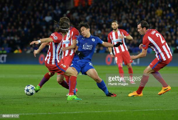 Shinji Okazaki of Leicester City in action with Filipe Luis and Diego Godin of Atletico Madrid during the UEFA Champions League Quarter Final Second...