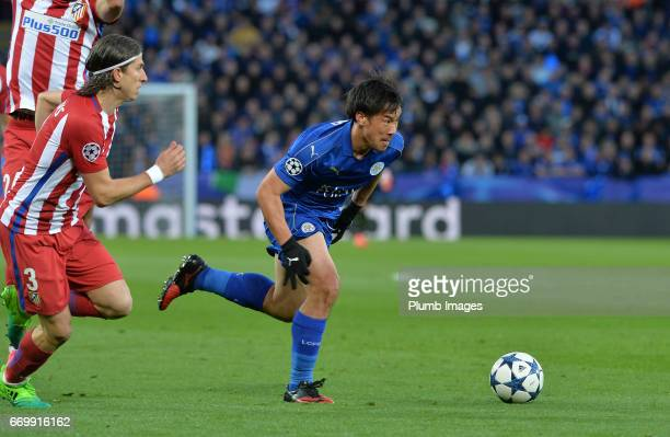 Shinji Okazaki of Leicester City in action with Filipe Luis of Atletico Madrid during the UEFA Champions League Quarter Final Second Leg match...