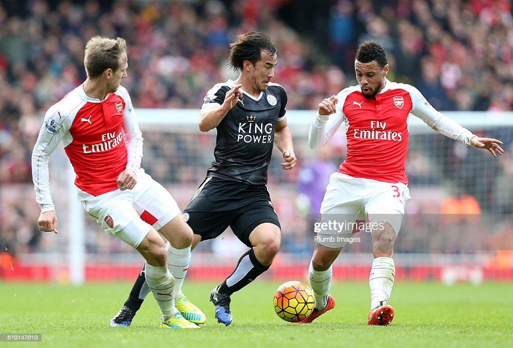 Shinji Okazaki of Leicester City in action with Francis Coquelin and Per Mertesaker of Arsenal during the Premier League match between Arsenal and Leicester City at Emirates Stadium on February 14, 2016 in London, United Kingdom.