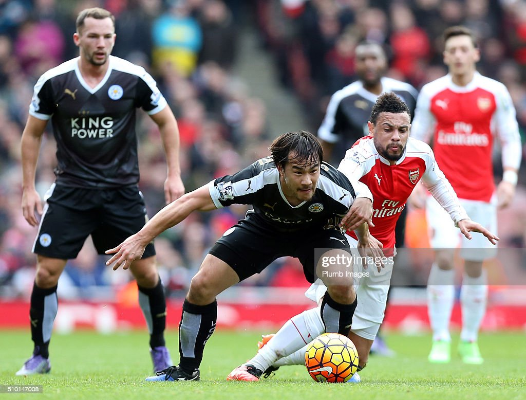 Shinji Okazaki of Leicester City in action with Francis Coquelin of Arsenal during the Premier League match between Arsenal and Leicester City at Emirates Stadium on February 14, 2016 in London, United Kingdom.