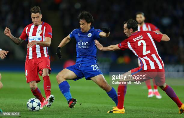 Shinji Okazaki of Leicester City in action with Jose Gimenez and Diego Godin of Atletico Madrid during the UEFA Champions League Quarter Final second...