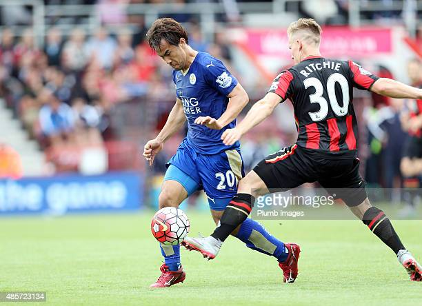 Shinji Okazaki of Leicester City in action with Matt Richie of Bournemouth during the Premier League match between Bournemouth and Leicester City at...