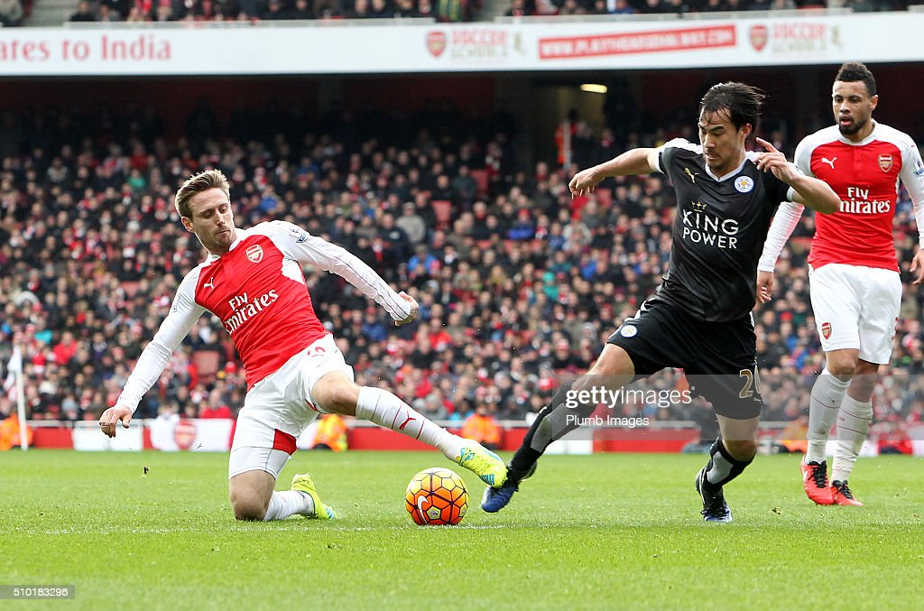 <a gi-track='captionPersonalityLinkClicked' href=/galleries/search?phrase=Shinji+Okazaki&family=editorial&specificpeople=4320771 ng-click='$event.stopPropagation()'>Shinji Okazaki</a> of Leicester City in action with <a gi-track='captionPersonalityLinkClicked' href=/galleries/search?phrase=Nacho+Monreal&family=editorial&specificpeople=4078049 ng-click='$event.stopPropagation()'>Nacho Monreal</a> of Arsenal during the Premier League match between Arsenal and Leicester City at Emirates Stadium on February 14, 2016 in London, United Kingdom.