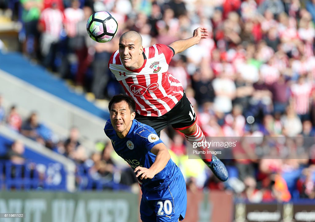 Shinji Okazaki of Leicester City in action with Orlol Romeu of Southampton during the Barclays Premier League match between Leicester City and Southampton at the King Power Stadium on October 2nd , 2016 in Leicester, United Kingdom.