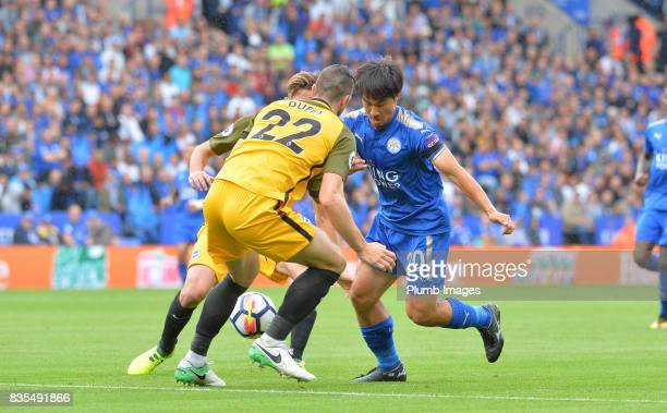 Shinji Okazaki of Leicester City in action with Shane Duffy of Brighton and Hove Albion during the Premier League match between Leicester City and...
