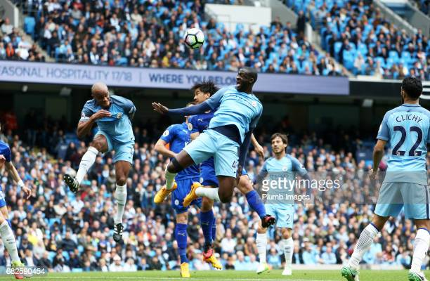 Shinji Okazaki of Leicester City in action with Yaya Toure of Manchester City during the Premier League match between Manchester City and Leicester...