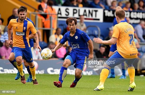 Shinji Okazaki of Leicester City is challenged by Adam Chapman of Mansfield Town during the pre season friendly match between Mansfield Town and...