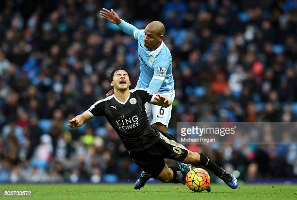 Shinji Okazaki of Leicester City is challenged by Fernando of Manchester City during the Barclays Premier League match between Manchester City and...