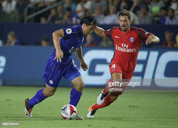 Shinji Okazaki of Leicester City is pursued by Benjamin Stambouli of Paris SaintGermain during the 2016 International Champions Cup at StubHub Center...