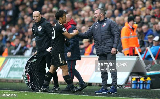 Shinji Okazaki of Leicester City is substituted by Caretaker Manager Michael Appleton of Leicester City during the Premier League match between...
