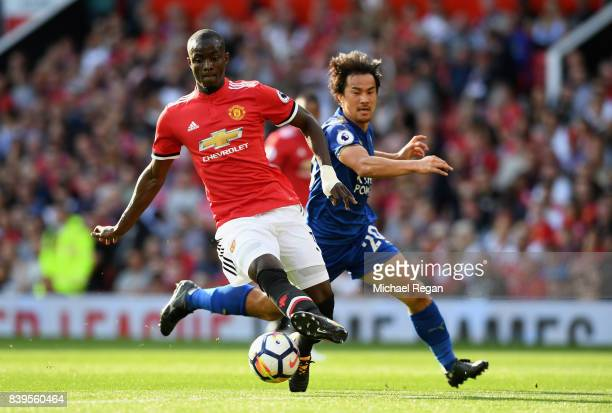 Shinji Okazaki of Leicester City puts pressure on Eric Bailly of Manchester United during the Premier League match between Manchester United and...