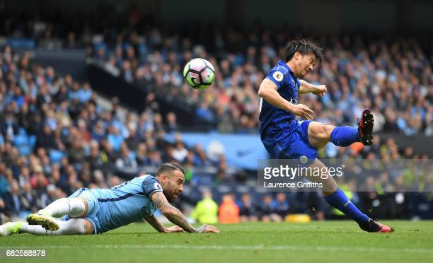 Shinji Okazaki of Leicester City scores his sides first goal during the Premier League match between Manchester City and Leicester City at Etihad...