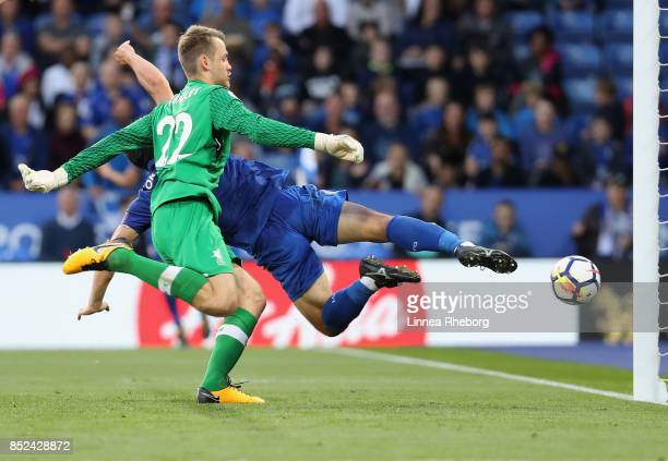 Shinji Okazaki of Leicester City scores his sides first goal past Simon Mignolet of Liverpool during the Premier League match between Leicester City...