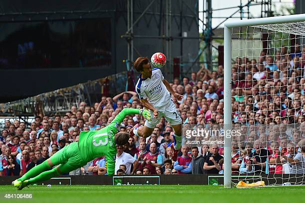 Shinji Okazaki of Leicester City scores his team's first goal during the Barclays Premier League match between West Ham United and Leicester City at...
