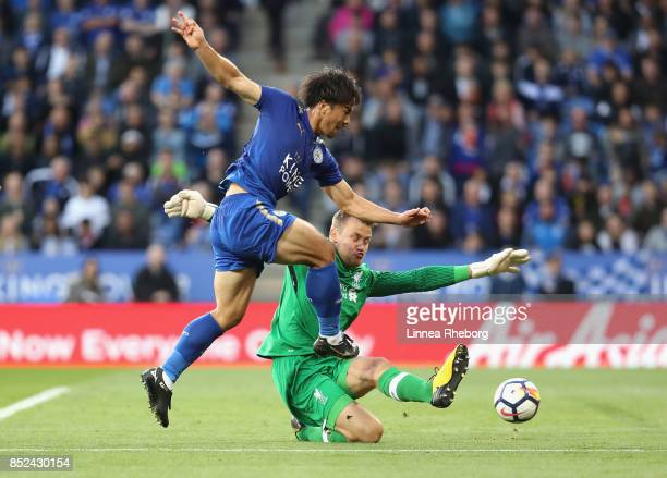 Shinji Okazaki of Leicester City scores shoots on goal past Simon Mignolet of Liverpool during the Premier League match between Leicester City and...