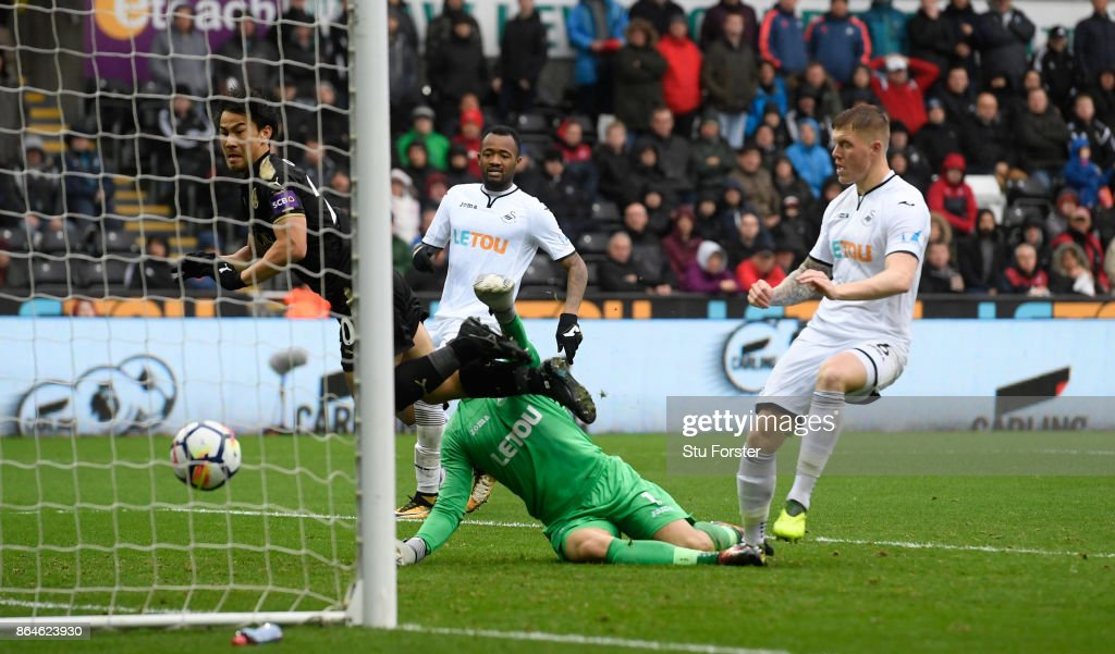 Shinji Okazaki of Leicester City scores the 2nd Leicester goal during the Premier League match between Swansea City and Leicester City at Liberty Stadium on October 21, 2017 in Swansea, Wales.