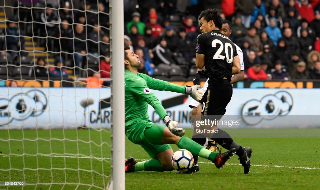 Shinji Okazaki of Leicester City scores the 2nd Leicester goal past Swansea goalkeeper Lucasz Fabianski during the Premier League match between Swansea City and Leicester City at Liberty Stadium on October 21, 2017 in Swansea, Wales.