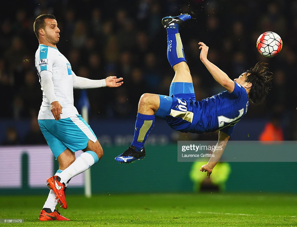 Shinji Okazaki of Leicester City scores their first goal with an overhead kick as Steven Taylor of Newcastle United looks on during the Barclays Premier League match between Leicester City and Newcastle United at The King Power Stadium on March 14, 2016 in Leicester, England.