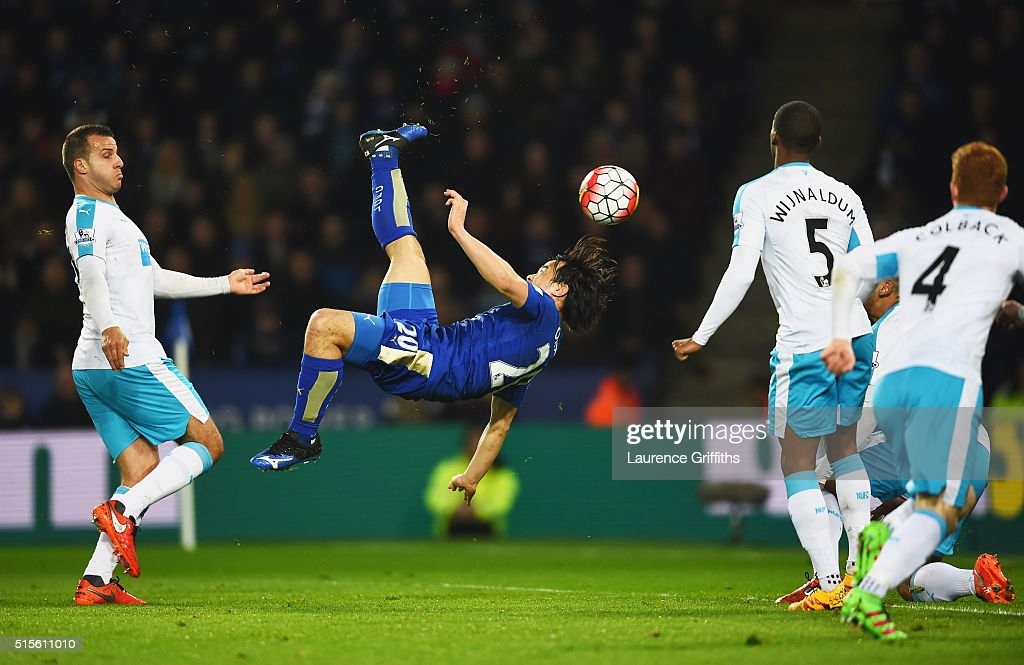 Shinji Okazaki of Leicester City scores their first goal with an overhead kick during the Barclays Premier League match between Leicester City and Newcastle United at The King Power Stadium on March 14, 2016 in Leicester, England.
