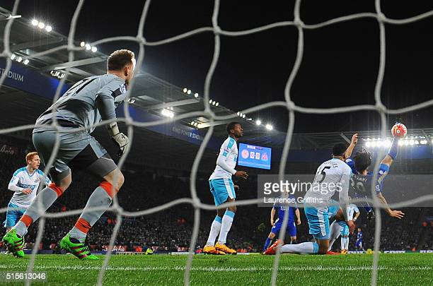 Shinji Okazaki of Leicester City scores their first goal with an overhead kick past goalkeeper Robert Elliot of Newcastle United during the Barclays...