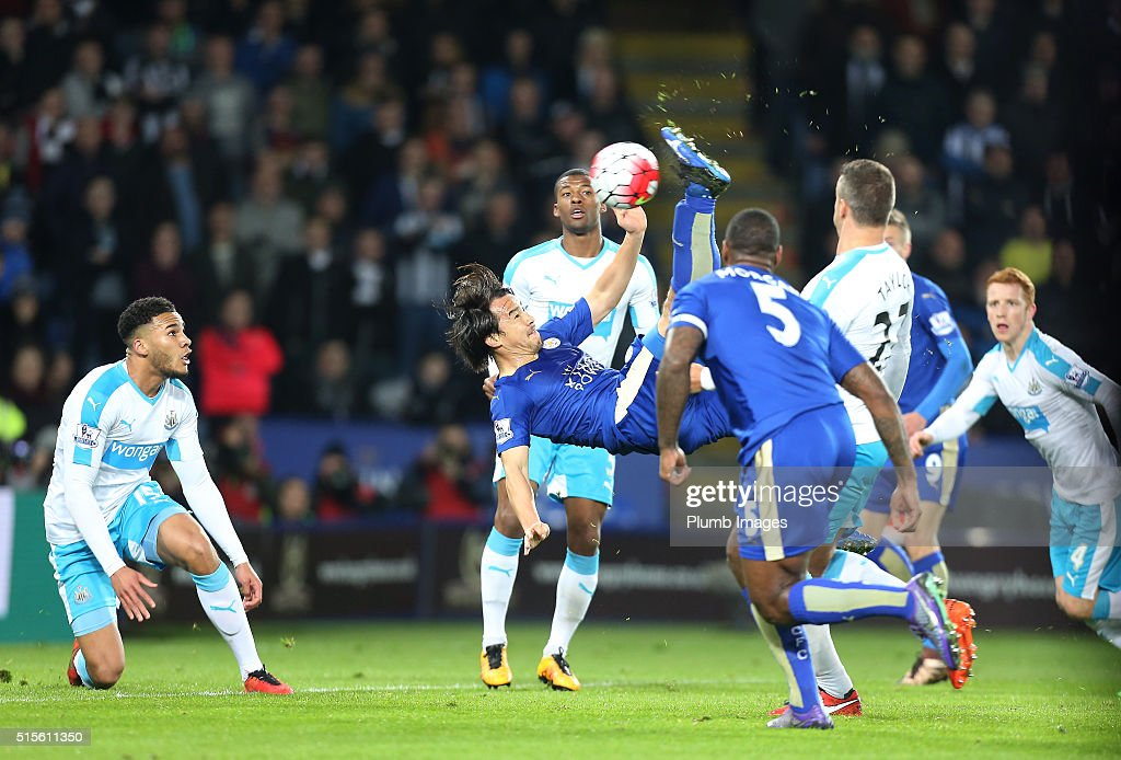 Shinji Okazaki of Leicester City scores with a bicycle kick to make it 1-0 during the Barclays Premier League match between Leicester City and Newcastle United at the King Power Stadium on March 14 , 2016 in Leicester, United Kingdom.