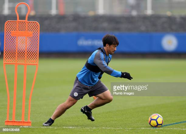Shinji Okazaki of Leicester City takes a tumble during the Leicester City training session at Belvoir Drive Training Complex on November 02 2017 in...