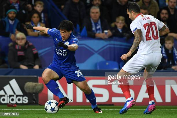 Shinji Okazaki of Leicester City takes on Vitolo of Sevilla during the UEFA Champions League Round of 16 second leg match between Leicester City and...